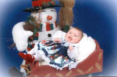 These Christmas studio portraits were taken on December 4th because Samantha's dress wasn't going to fit by Christmas!