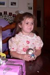 Samantha shows off her snowglobe. . . the very same one that Mama and Da tried to give her for Christmas.  However, the first one broke due to freezing before Sammi ever got to see it.  Oma went back to Jamestown to get a new one.