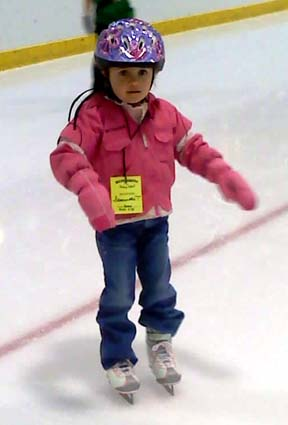 Sam at ice skating lesson #3.  She made it the whole time without holding anybody's hand!