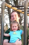 Uncle Aaron shows Sam the ropes on the monkey bars at the park.