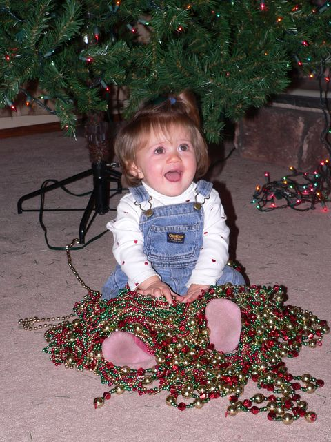 We were very proud of Samantha for not being afraid of the tree that appeared in her living room after her nap.  But as nice as it was, the beads were much more interesting.